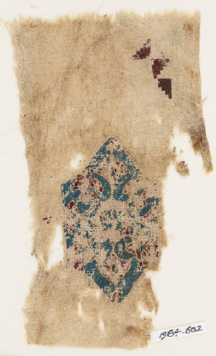 Textile fragment with large hexagonal diamond-shape
