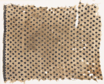 Textile fragment with diamond-shapes and a border of heart-shaped flowers