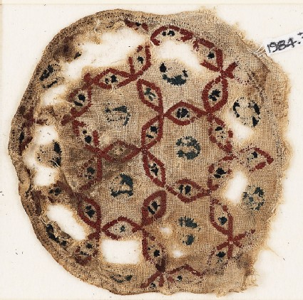 Roundel textile fragment with interlacing hexagons