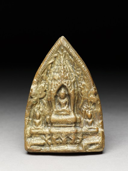 Votive plaque of the Buddha with attendant figures