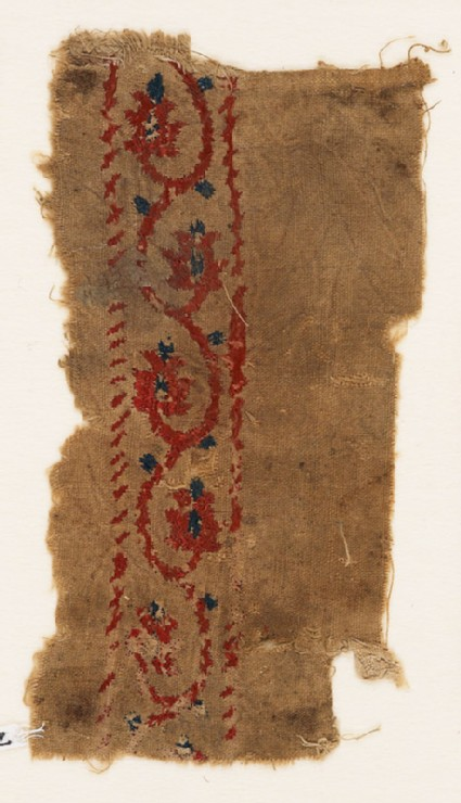 Textile fragment with vine and flower-heads
