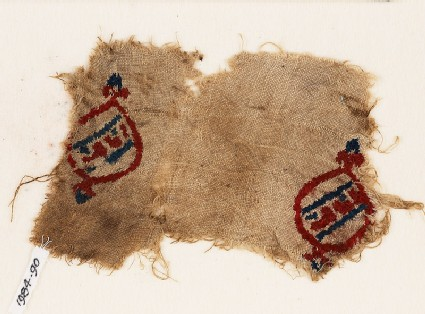 Textile fragment with blazons and inscription