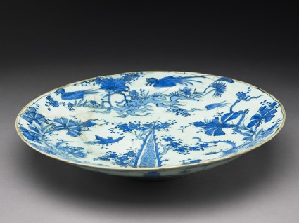 Dish with birds in a landscape