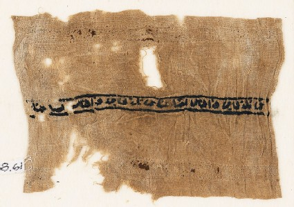 Textile fragment with band of inscription