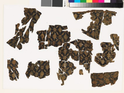 Group of textile fragments with medallions and stars