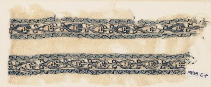 Textile fragment with bands of linked leaves or palmettes