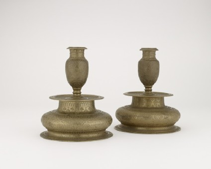 Candlestick with floral decoration
