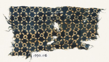 Textile fragment with rings and quatrefoils