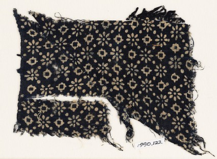 Textile fragment with rosettes, lobed squares, and dots