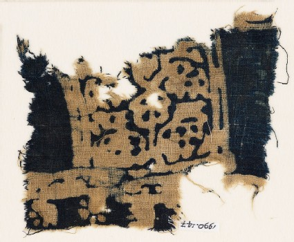 Textile fragment, possibly with squares and stylized animals