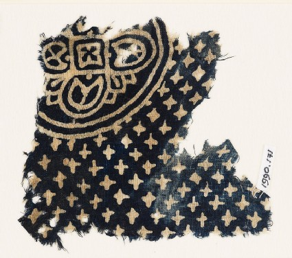 Textile fragment with large quatrefoil and small stars