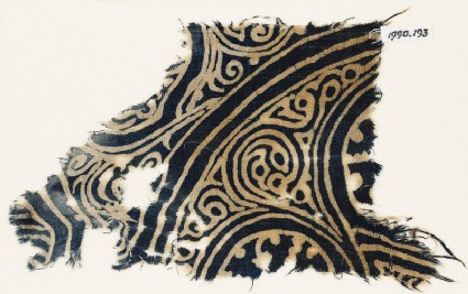 Textile fragment with swirling tendrils