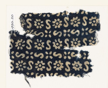 Textile fragment with S-shapes, rosettes, and flowers