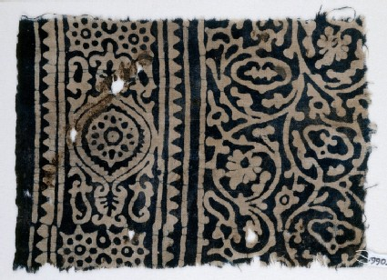 Textile fragment with vines and tendrils, a medallion, and rosettes