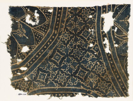 Textile fragment with large rosettes and stepped squares