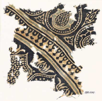 Textile fragment with tear-drops and stylized flower-heads