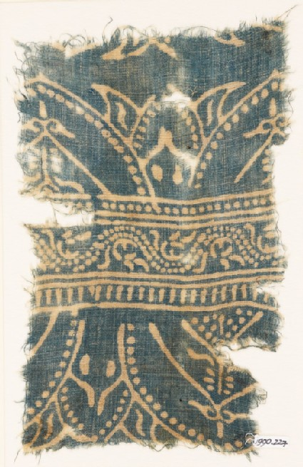 Textile fragment with arches and dotted vine