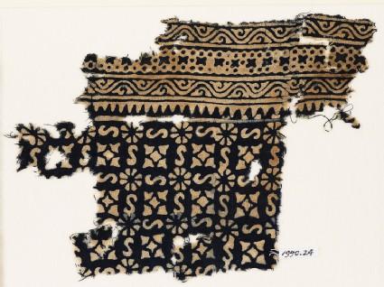 Textile fragment with S-shapes, rosettes, and quatrefoils
