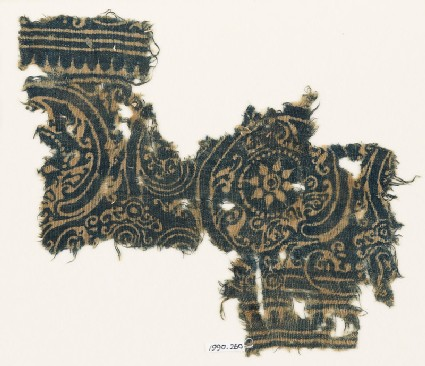 Textile fragment with linked scrolls