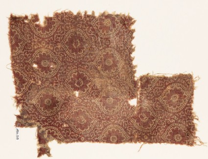 Textile fragment with medallions, flowers, and tendrils