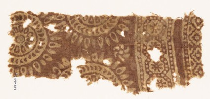 Textile fragment with circles and petals