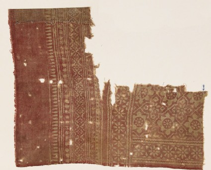 Textile fragment with rosettes set into linked stars