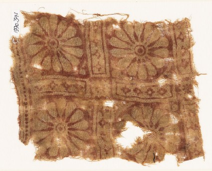 Textile fragment with rosettes in a grid