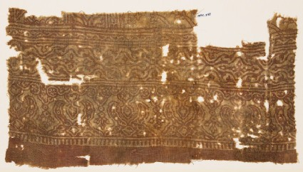 Textile fragment with stylized plants linked to form medallions
