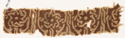 Textile fragment with interlace forming flower-shapes