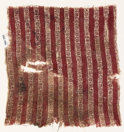 Textile fragment with bands of flowers