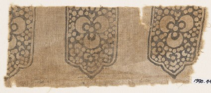 Textile fragment with tab-shapes, trefoils, and dots