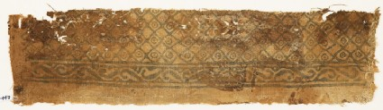 Textile fragment with grid of squares and circles