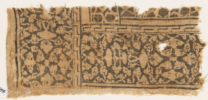 Textile fragment with floral patterns, leaves, and interlace