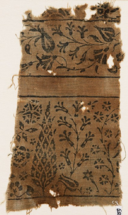 Textile fragment with stylized tree, flowering plants, vine, and flower-heads