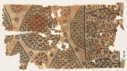 Textile fragment with tear-drops filled with scales, and stylized trees and flowers