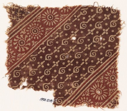 Textile fragment with spirals, dots, and rosettes