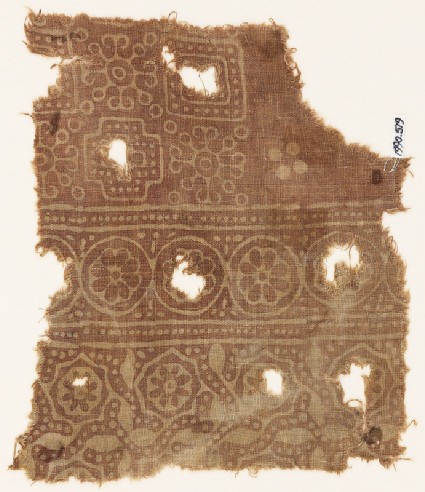 Textile fragment with rosettes in circles, stepped squares, and Maltese crosses