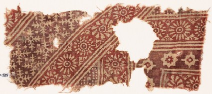 Textile fragment with rosettes, serrated crosses, stars, and dots