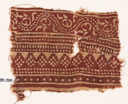 Textile fragment with bands of dotted patterns and vine