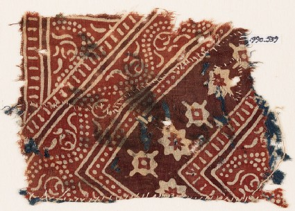Textile fragment with stylized vine, rosettes, and diamond-shapes