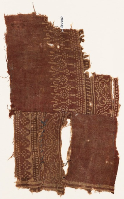 Textile fragment with dotted vines, possibly stylized columns, and poles with rosettes