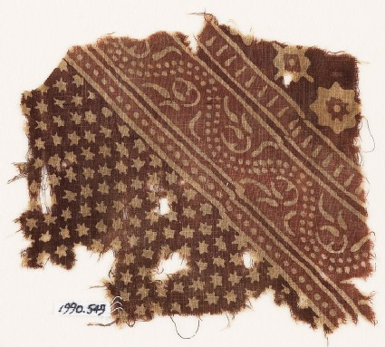 Textile fragment with small and large stars, and a dotted vine