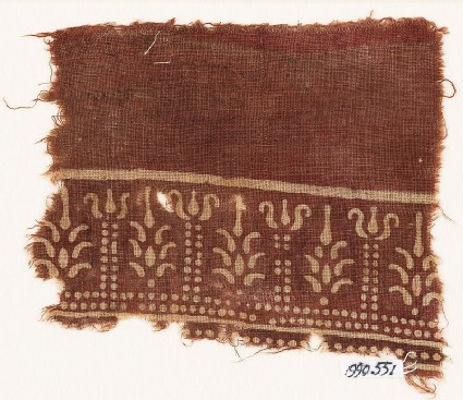 Textile fragment with columns and stylized trees