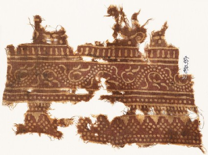 Textile fragment with dotted vine and rhombic shapes