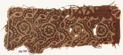 Textile fragment with dotted tendrils and small rosettes in circles