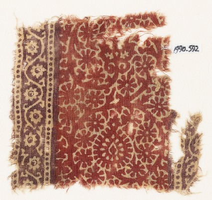 Textile fragment with scroll, flower-heads, and rosettes