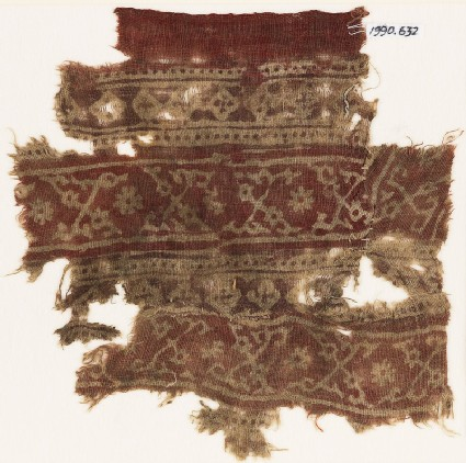 Textile fragment with bands of crossed tendrils, rosettes, and linked squares