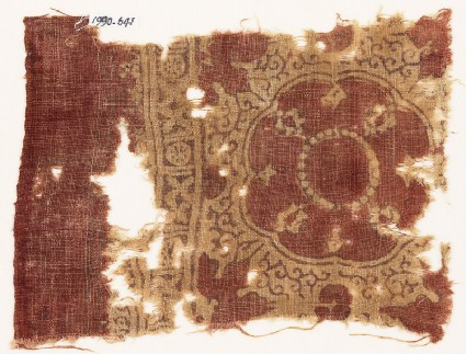 Textile fragment with large medallion, floral shapes, crosses, and circles