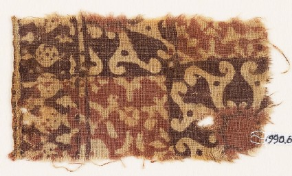 Textile fragment with squares, spirals, and possibly tendrils