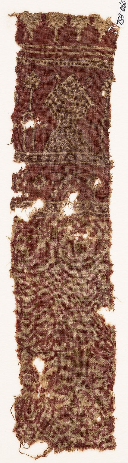 Textile fragment with tendrils, leaves, flower-heads, and floral designs